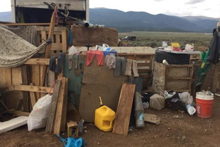 Five charged with child abuse after 11 emaciated children found in trailer