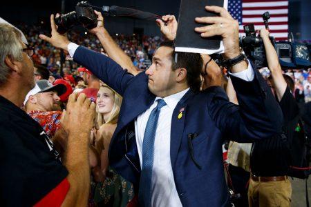 Trump volunteer blocks news photographer's camera at Indiana rally