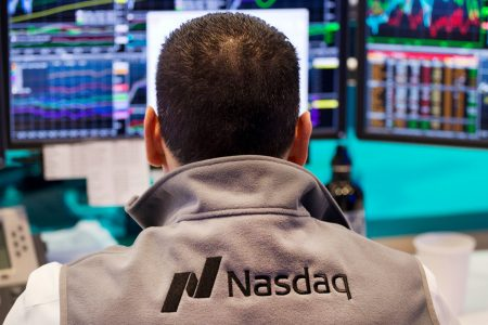 Nasdaq tops 8000 for first time, led by Apple, Netflix, Amazon