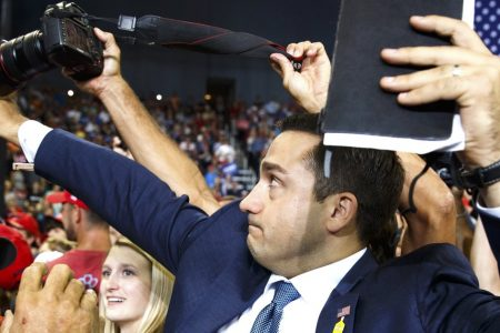 Trump Volunteer Tries To Block Journalist From Photographing Protester At Rally
