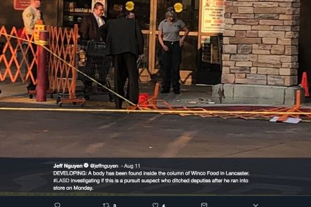 Decomposing body found in pillar outside grocery store linked to fugitive in California