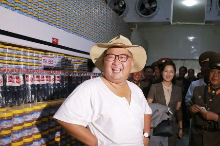 Amid heatwave, North Korea's leader Kim Jong Un ditches trademark Mao-style suit for summer clothes, straw hat