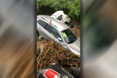 New Jersey flash floods send cars floating down river, piling up against bridge