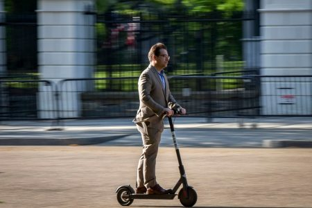 The electric scooters swarming our city won't solve our commuting calamity