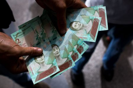 Venezuela is swept by economic chaos as new currency plan takes effect