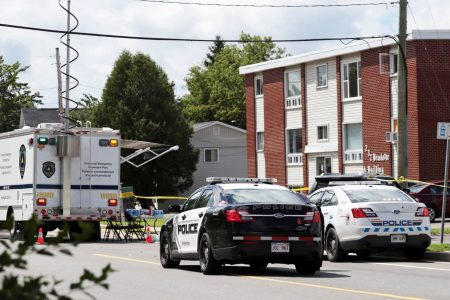 UPDATE 10-Two police officers among four fatally shot in Canada -authorities