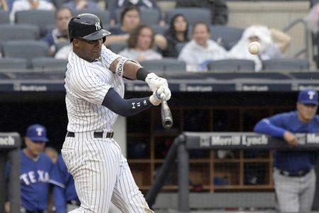 Chapman, Yankees weather heavy rain, hold off Rangers 5-3