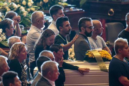 Italy's leader comforts mourners at funeral as bridge toll rises