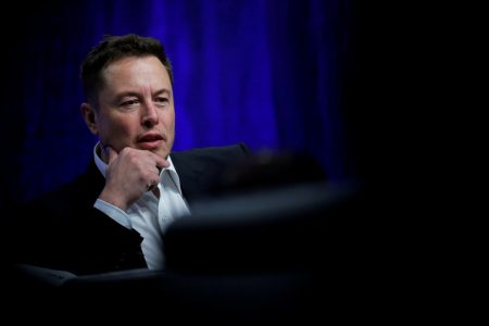 Tesla Shares Shaken by Accounting Chief's Exit and Musk's Pot Smoke