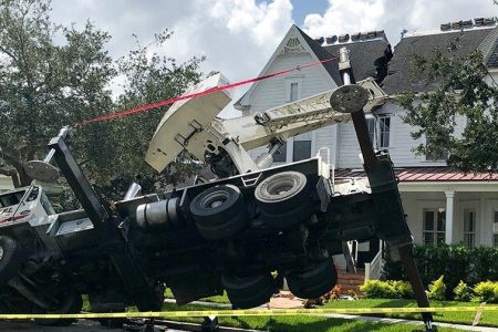 Crane smashes into Florida house, splits open roof, fire officials say