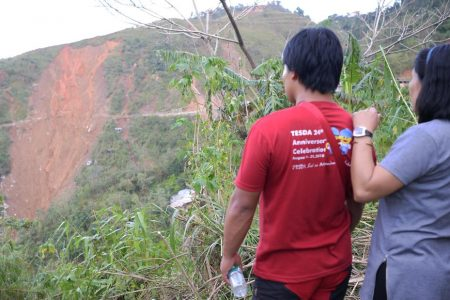Philippines typhoon: Rescuers race to find landslide survivors
