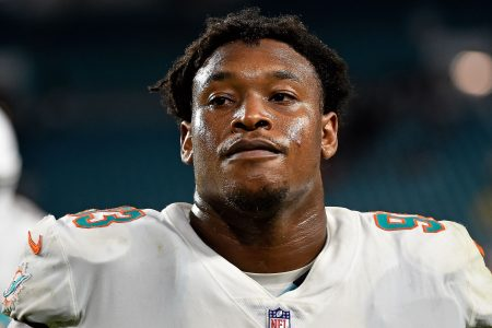 Dolphins' Akeem Spence ejected for ripping Raiders G Kelechi Osemele's helmet off