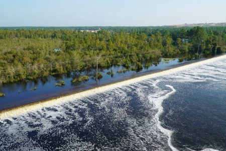 Dam breach sends toxic coal ash flowing into a major North Carolina river