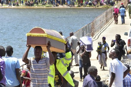 Death toll from capsized ferry rises to 224 as burials begin