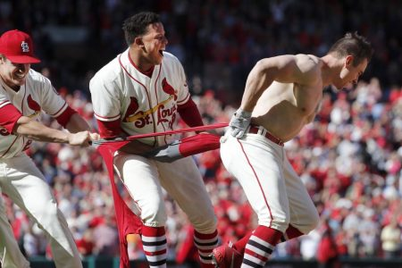 Cardinals celebrate Tyler O'Neill's walk-off HR by ripping the shirt off his back