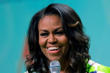 Michelle Obama helps a Chicago couple say 'I do' by officiating (!) at the wedding