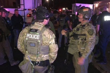 Man armed with multiple guns including rifles takes hostage in Tacoma, Washington