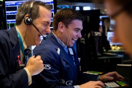 Dow hits record earlier in day, but stocks close little changed as rising rates spook investors