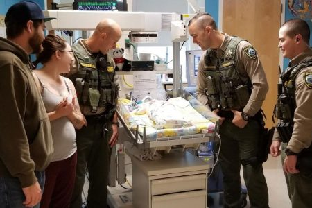 Oregon officers reunite with infant they saved