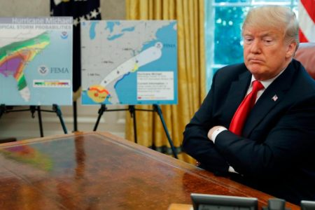 Trump bets there's no downside to campaigning as hurricane rages