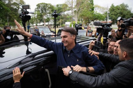 Brazilians vote in presidential election, with a Trump fan as front-runner