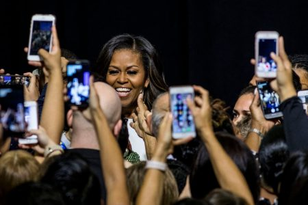 Michelle Obama's vacation is over. Now she's claiming her own spotlight.