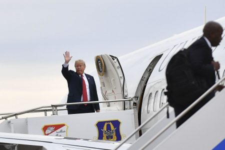 Trump boards Air Force Once with toilet paper in tow