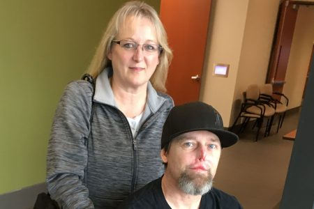 After losing legs, hands to infection from dog lick, man's optimism never wavered
