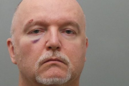 Critic of gun control and former pastor charged in religious store shooting, sexual attack