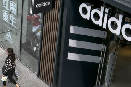 Adidas hikes 2018 profit guidance, trims sales outlook