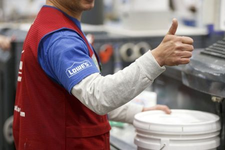 Lowe's earnings beat, but retailer cuts forecast as it moves to exit some businesses