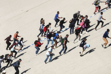 Migrants Run to US Border in Tijuana, but Fall Back in Face of Tear Gas