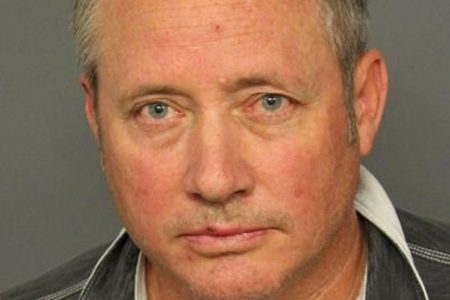 United pilot faces indecency charge after he was seen standing naked at hotel window