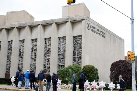 Man arrested on gun charges said synagogue shooting victims 'deserved it,' say court docs
