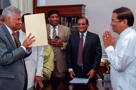 Sri Lanka's prime minister reinstated, ending political crisis – The Washington Post