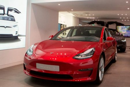Tesla is raising prices after backtracking on store closures – CNN